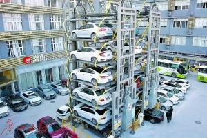 广州现立体车库7层高如摩天轮 4个车位容纳24辆车